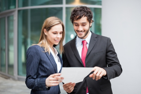 professional man: Business people reading a document together