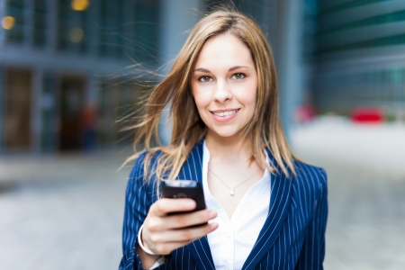 Portrait of a woman using a cell phone photo