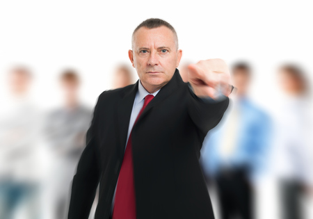 Businessman pointing his finger to you photo