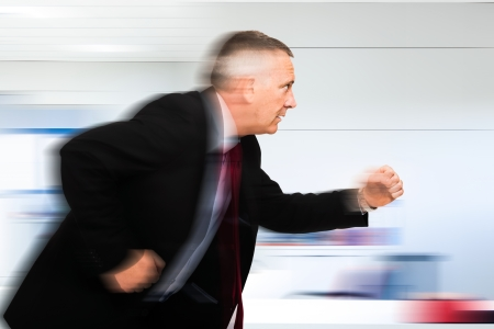 the end of time: Businessman running in his office