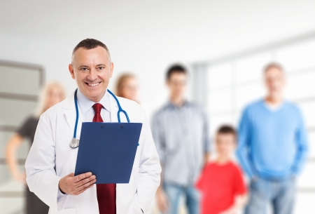 insurance consultant: Portrait of a smiling family doctor Stock Photo