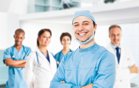 team leader: Portrait of a smiling doctor in front of his team Stock Photo