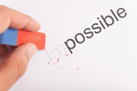 transformed: Concepto de negocio: la motivaci�n. Palabra imposible transforma en posible. Foto de archivo