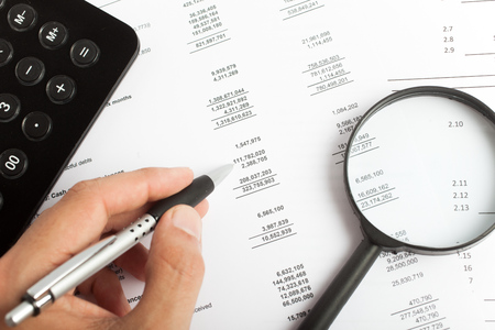 Man working on business documents photo