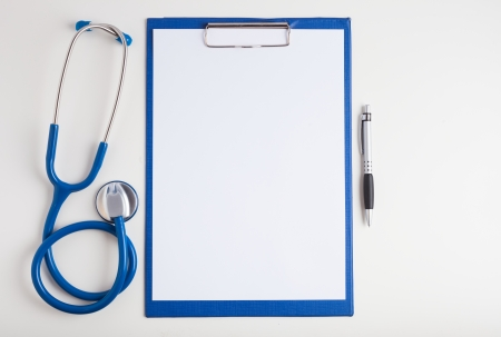 pads: White paper, stethoscope and a pen Stock Photo