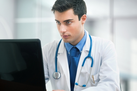 traineeship: Doctor using a laptop computer on his desk