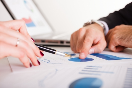 financial team: Detail of people at work during a business meeting