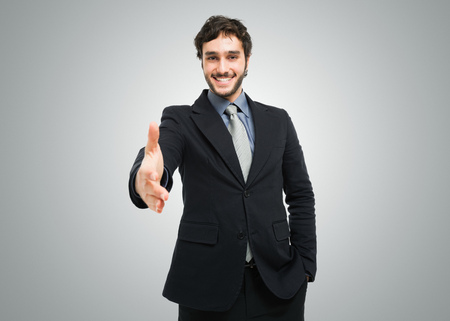 Young businessman giving an handshake