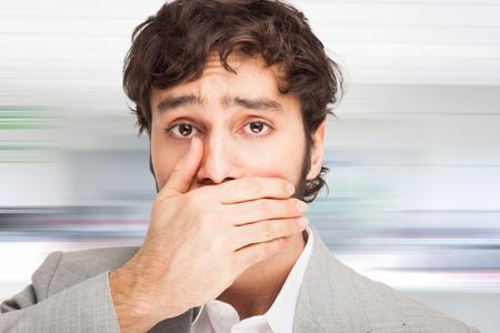 Man shutting his mouth photo