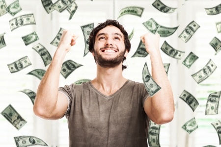 money rain: Portrait of a very happy young man in a rain of money Stock Photo