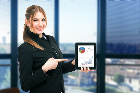 Businesswoman showing financial reports on a tablet computer photo