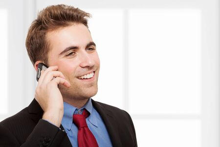 Handsome businessman talking on the phone photo