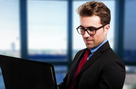 Portrait of a businessman using his laptop photo
