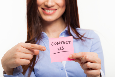 write us: Woman showing a contact Stock Photo