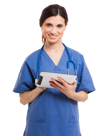 Smiling nurse using a digital tablet photo