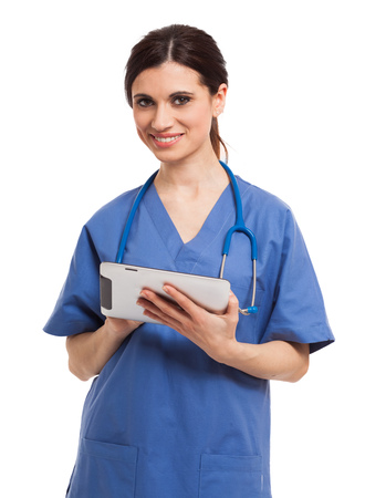 Portrait of a female doctor using a digital tablet  Isolated on white photo