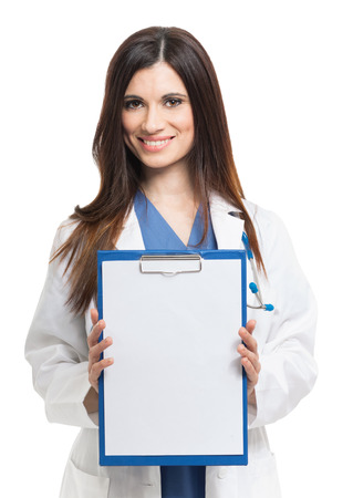 Female doctor showing a sheet of white paper  Isolated on white Stock Photo - 22770549