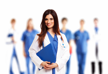 medical clipboard: Smiling doctor in front of her medical team Stock Photo