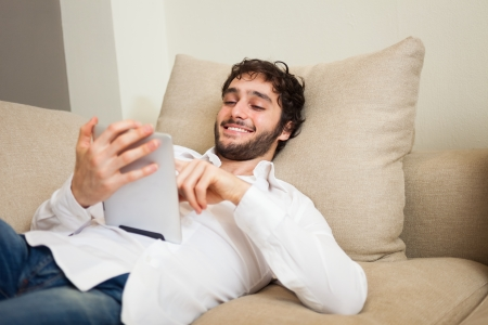 Young man using a digital tablet Stock Photo - 22770604