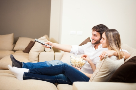 Young couple preparing to watch a movie Stock Photo - 22770608