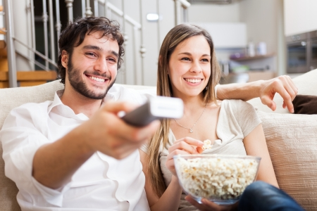 love movies: Young couple preparing to watch a movie