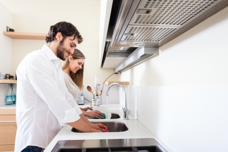 Young couple doing dishes in the kitchen photo