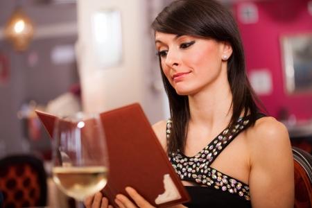 Woman choosing food in a restaurant photo
