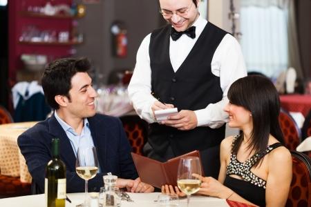 ordering: Couple ordering dinner in a restaurant