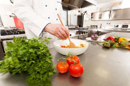 Chef preparing vegetables in his kitchen photo