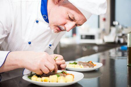 garnishing: Professional chef garnishing a dish