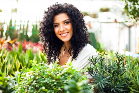 Portrait of a smiling woman in a greenhouse photo