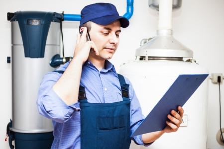 plumbing repair: Technician servicing an hot-water heater