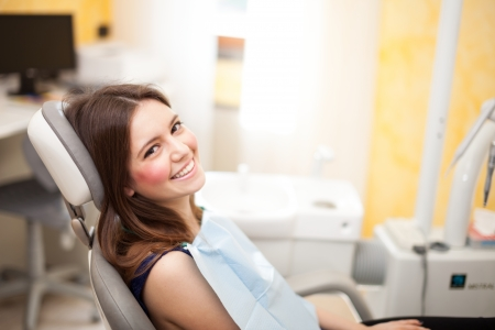 examination: Woman waiting for a dental exam Stock Photo