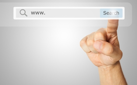 find: Finger clicking a search button Stock Photo
