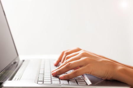 Close-up of a woman using a laptop computer Stock Photo - 22770978