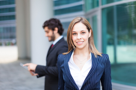 young girl smiling: Business people in an urban environment Stock Photo