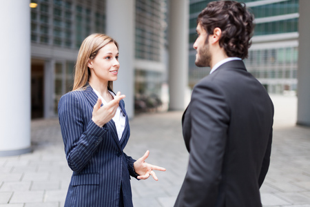 Discussion between business people Stock Photo - 22784432