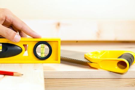 bubble level: Detail of a carpenter using a bubble level