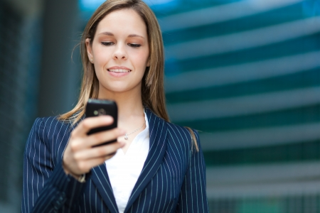 Happy woman writing a text message Stock Photo - 22786612