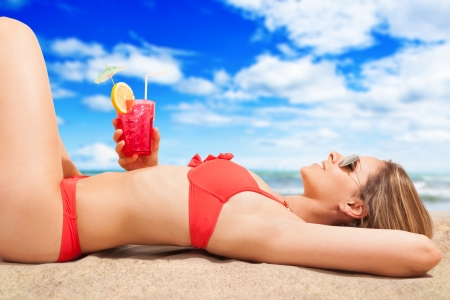 Beautiful woman relaxing on the beach photo