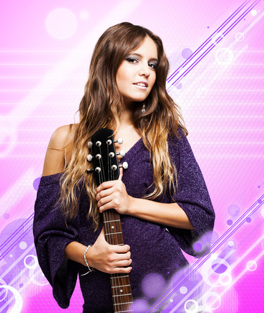 Fashion portrait of a woman holding an electric guitar photo
