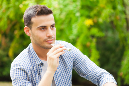 pv: Man smoking an electronic cigarette outdoor Stock Photo