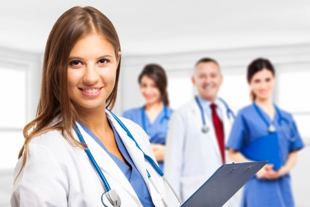 traineeship: Portrait of a smiling doctor in front of her team Stock Photo