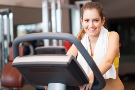 sports hall: Young woman training in a gym Stock Photo