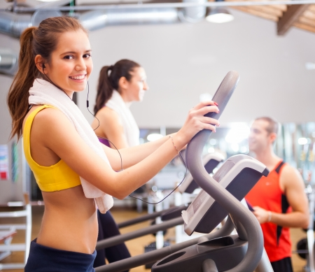 sports hall: Woman doing fitness in a gym