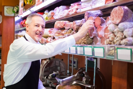 human meat: Shopkeeper serving a customer in a grocery store