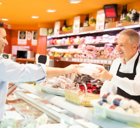 Shopkeeper serving a customer in a grocery store photo