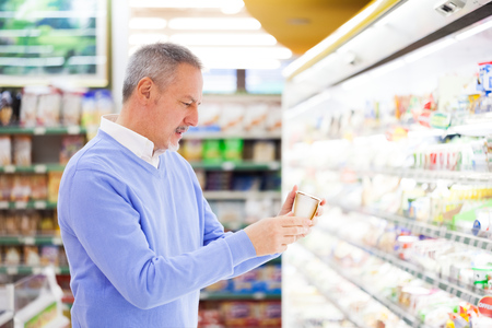 better price: Man shopping in a supermarket