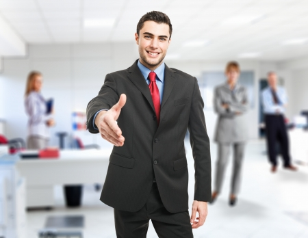 Portrait of an handsome businessman giving an handshake Stock Photo
