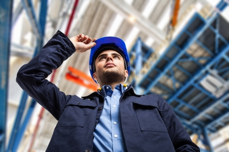 Portrait of an engineer in a factory photo